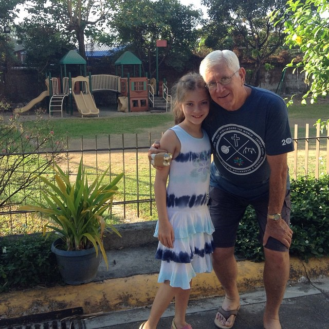 Morgan and her former principal Mr. Major in front of…